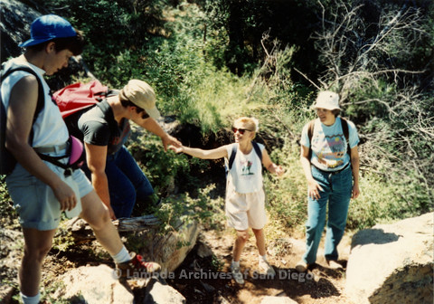 P008.143m.r.t Cuyamaca 1991: Hikers helping each other along the trail