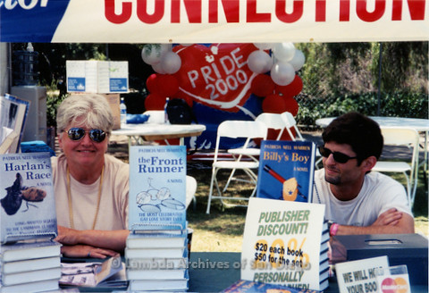 P018.174m.r.t San Diego Pride Festival 2000: Patricia Nell Warren & assistant selling books
