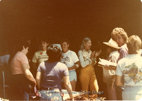 Blood Sisters blood drive 1983: Bridget Wilson (pink shirt), Ann Ramsey (orange pants) tabling with other volunteers outside Blood Bank