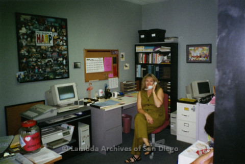 P239.015m.r.t The Center on Normal Street: Woman sitting in office, on phone