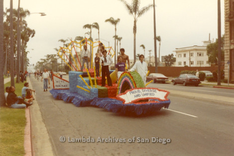 1982 - San Diego Pride Parade, 'W.C.P.C.' (West Coast Production Company Gay Dance Club) Contingent Float. The banner on the float reads: 'Proud, Diverse and Unified' the 1982 Pride theme.