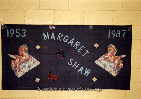 P019.051m.r.t AIDS Quilt at San Diego Golden Hall 1988: Violet quilt decorated with butterflies and Pegasus dedicated to Margaret Shaw