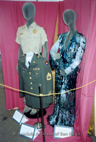 San Diego Pride Festival, July 1992: Police uniform, military uniform, and costume dress on display