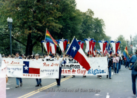 "P019.234m.r.t Second March on Washington 1987: Men and women marching with banner that reads: ""FOR LOVE FOR LIFE  HOUSTON OCTOBER 11, 1987"""