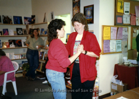 P169.057m.r.t Paradigm Women's Bookstore Grand Opening: Karen Merry and another woman dancing at bookstore