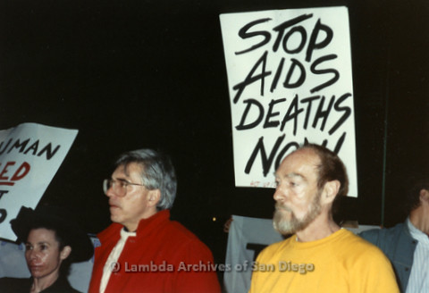 """P019.378m.r.t Los Angeles """"Die In"""" 1988: Group marching with signs, one reads: """"STOP AIDS DEATHS NOW! ACT UP/LA"""""""