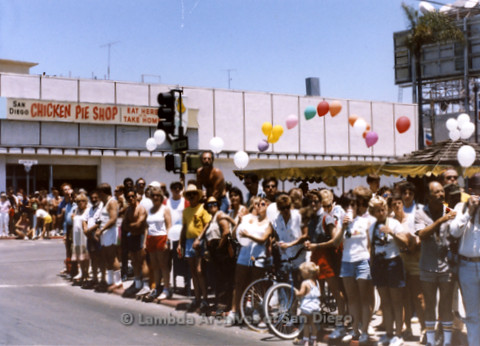 San Diego Lambda Pride Parade: Crowd Watching the Parade in the Parking Lot of Thrifty's, at the Corner of Fifth and Robinson Avenue, in the Back Ground is the Original Chicken Pie Shop in Hillcrest.