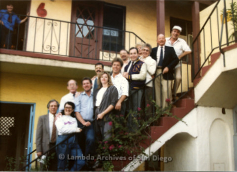 P019.200m.r.t AIDS Quilt at San Diego Golden Hall 1988: Group of people standing on a stairwell, including Jess Jessop, Albert Bell, Nicole Murray Ramirez, and Herb King
