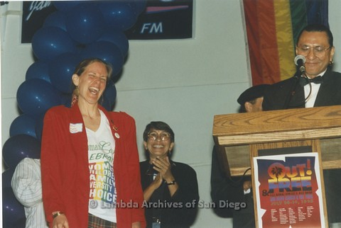 1995 - San Diego LGBT Pride Rally: 'Out And Free' Pride Awards: Lesbian Performer,Vickie Randle (left), Professor Bonnie Zimmerman (center seated) and LGBT Pride Board Co-Chair Larry Baza (right).
