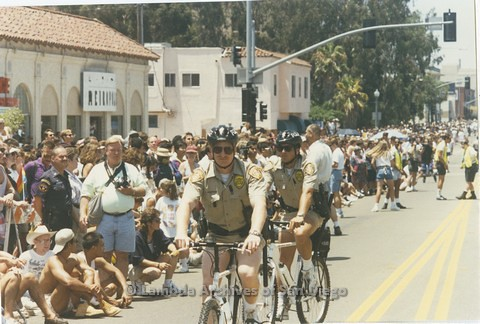 "1995 - San Diego LGBT Pride Parade"" Police monitoring the Parade Crowd."