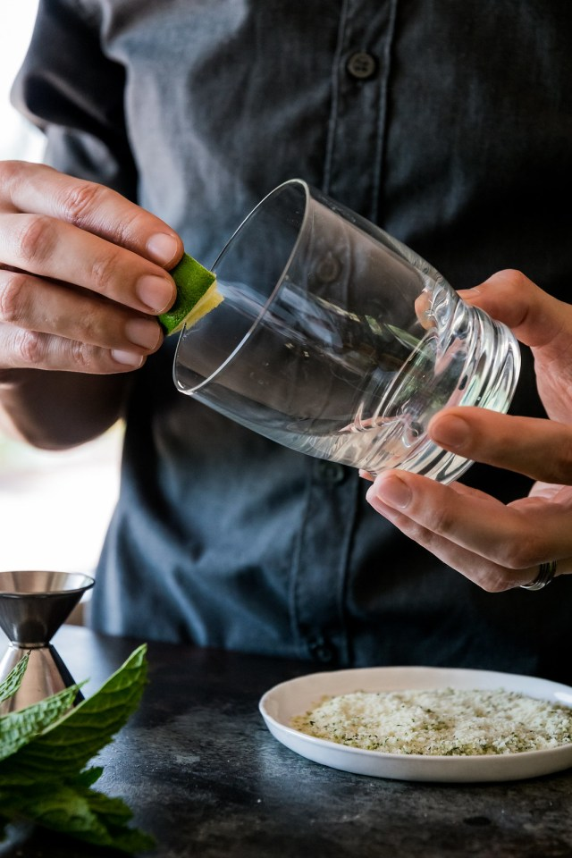 rubbing the rim of the glass with lime