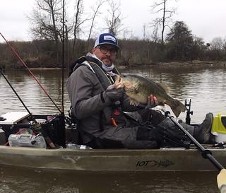 Photo of man holding up a nice largemouth bass