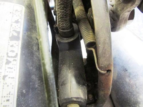 Rear Brake Pedal Return Spring Fits In Hole in The Muffler Bracket