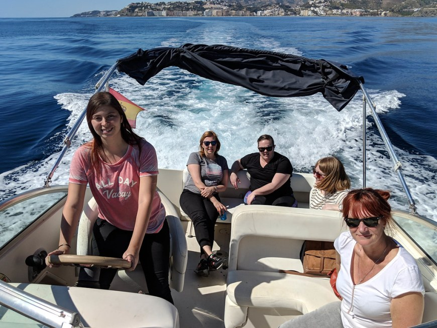 A group of people enjoying a speed boat ride on the sea