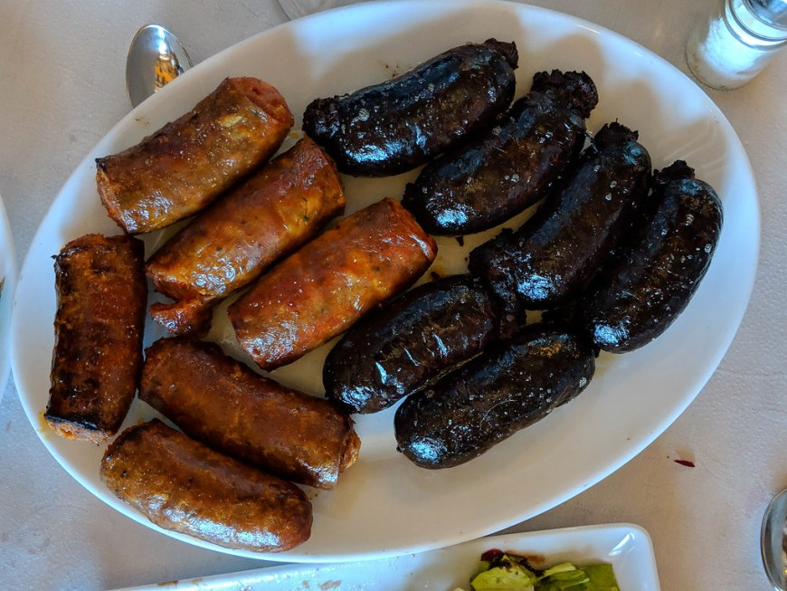 A plate with sausages and morcilla - a Spanish type of blood sausage