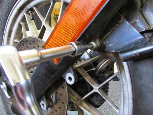 Remove Front Caliper Brake Line Bracket