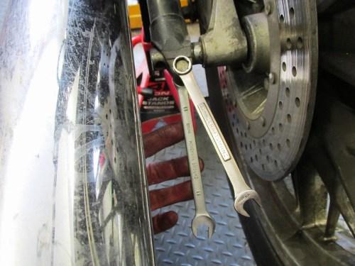 Remove Rear Axle Pinch Bolt