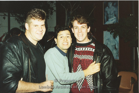 P001.266m.r.t X-mas: 3 men, one wearing a red patterned sweater