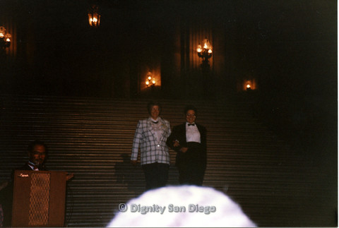P103.133m.r.t Dignity Ninth Biennial Convention, San Francisco, 1989: Two women descending stairs in tuxedos
