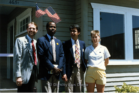 P103.177m.r.t San Diego Dignity Center: Bruce Neveu (left) standing in front of Center with Stan Lewis, unidentified man and unidentified woman (right)