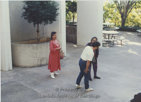 P024.047m.r.t LCCA: Left to right- Jo-Elyn Nourie, Muriel Fisher, Unknown, in white shirt. Outside SDSU