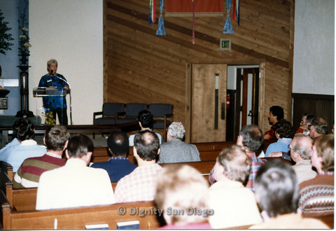 "P103.088m.r.t Dignity San Diego: ""Heather"" speaking to the congregation during church"