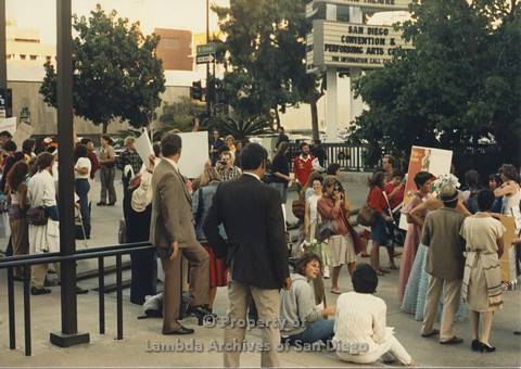 P024.114m.r.t Myth California Protest, San Diego, June 1986: shot of crowd, 2 men in the center in suits