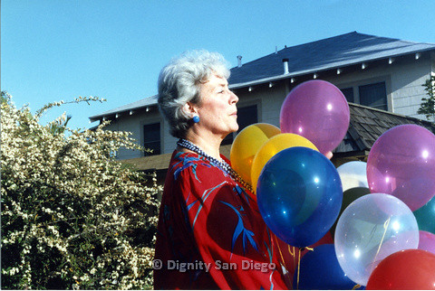 P103.179m.r.t San Diego Dignity Center: Profile of woman with balloons in front of Center