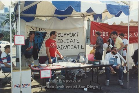 P001.125m.r.t AIDS Walk 1991: AIDS Foundation San Diego Booth with a banner ( AIDS Foundation San Diego: Support, Educate, Advocate)