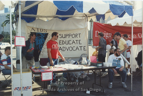 P001.125m.r.t AIDS Walk 1991: AIDS Foundation San Diego Booth with a banner ( AIDS Foundation San Diego: Support, Educate, Advocate)