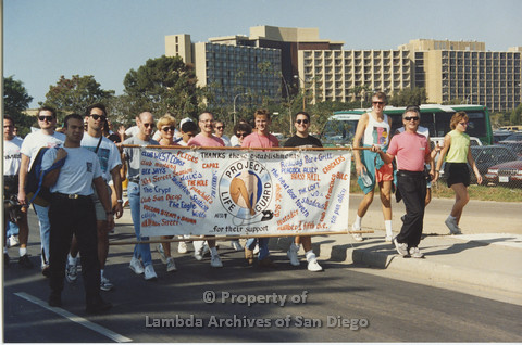 P001.114m.r.t AIDS Walk 1991: People walking behind a banner (Project Life Guard)