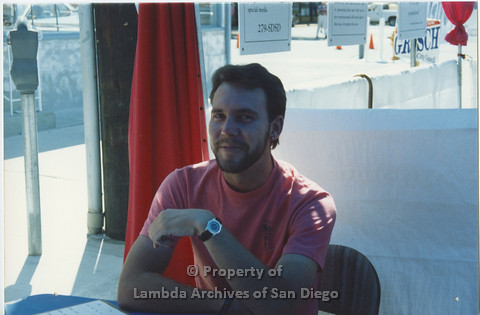 P001.104m.r.t City Fest 1991: 1 AIDS Foundation San Diego vollunteer in booth