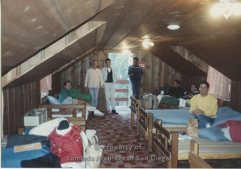 P001.188m.r.t Retreat 1991: group photo inside a cabin