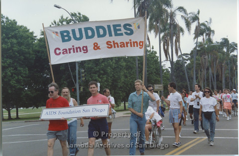 "P001.052m.r Pride 1991: Pride Parade ""AIDS Foundation San Diego"" walking in Pride Parade, banner (Buddies Caring and Sharing)"