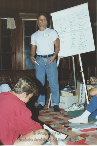 P001.200m.r.t Retreat 1991: man in front of an easel pad wearing a nametag (Andrew)