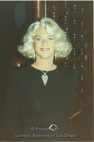 P001.259m.r.t Through The Years Fundraiser: drag queen in blond wig and black dress