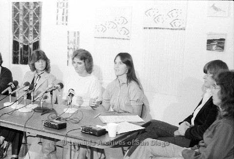 P123.034m.r.t Dixon Press Conference 1982:  (Left to Right) Fran Ledford, Chris Russell, Eileen Bingle, Susan McGreivy (ACLU), and  Kim McAlister (CWSS), with Eileen speaking.