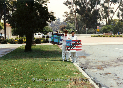 """P024.514m.r.t 1990 San Diego Pride: Pamela Gusha (on left) holding a sign that reads, """"Lesbians are everywhere"""" and Diane Germain (on right) holding sign that reads, """"Lesbians for choice"""""""
