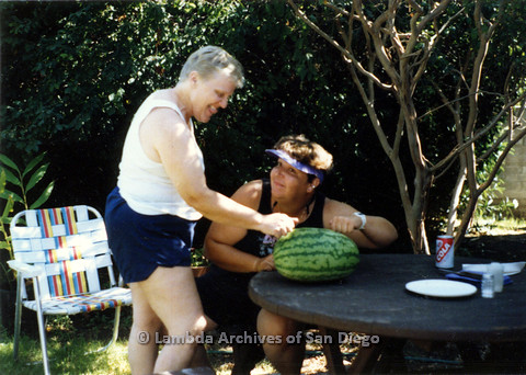 P024.318m.r.t Commonwealth: Sally Hopkins (left) examines a watermelon with another woman.