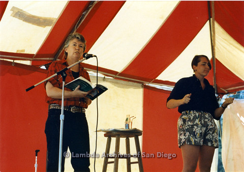P024.249m.r.t Judy Grahn (left) speaking in to microphone beside ASL translator (right).