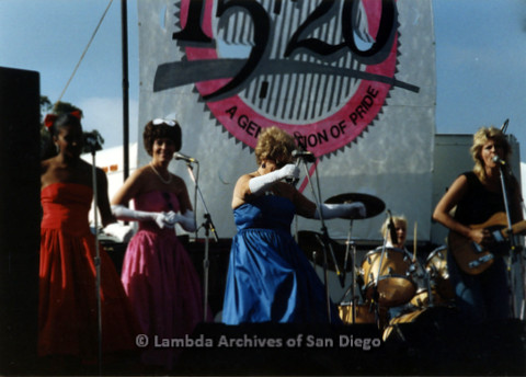 P024.399m.r.t 1989 San Diego Pride: Female Band performing on stage with back up singers