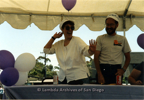 P024.430m.r.t 1990 San Diego Pride festival: Lois Gail and unknown man behind a table at the festival