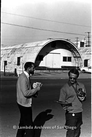 P180.014.02m.r.t Two men with cameras