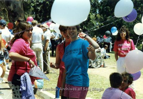 P024.527m.r.t 1990 San Diego Pride Parade: Woman in blue San Diego Lesbian Press shirt