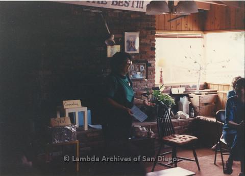 P024.366m.r.t  Michael Ann speaks while standing by a chair