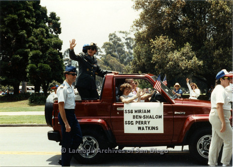 P024.418m.r.t 1990 San Diego Pride parade: SSG Miriam Ben-Shalom and Perry Watkins in military uniform on back of a parade truck