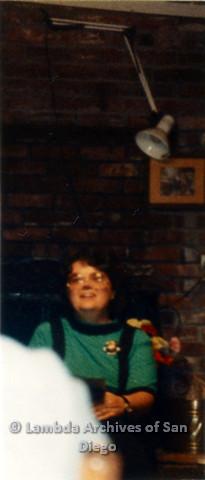 P024.384m.r.t A seated Michael Ann wearing a teal shirt.