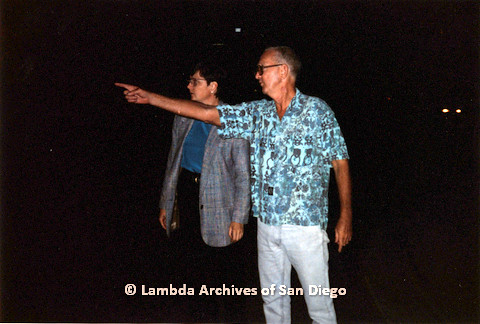 P151.025m.r.t Christine Kehoe and a man with glasses in blue shirt pointing
