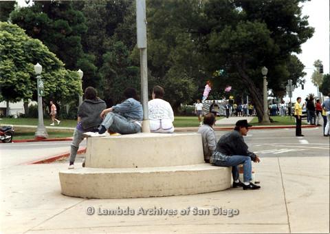 P024.472m.r.t 1990 San Diego Pride Parade: people sitting around a pole