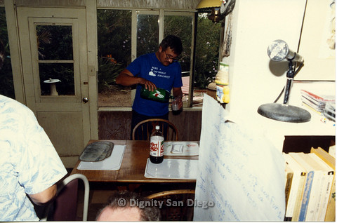 P103.080m.r.t Dignity San Diego: Man in blue pouring 7-UP